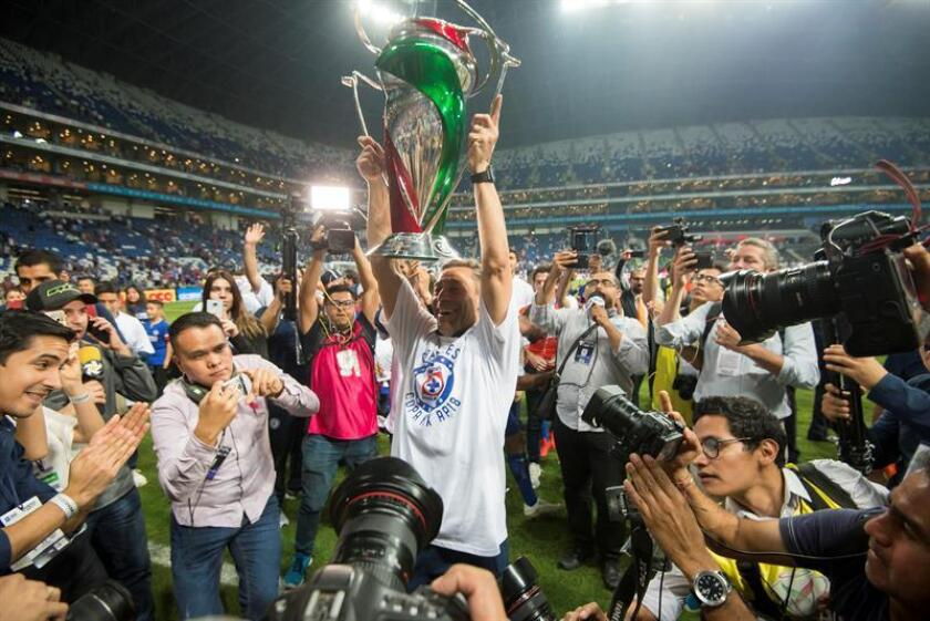 Cruz Azul manager Pedro Caixinha (C) celebrates with his players after winning the 2018 Copa MX final against Monterrey on Oct. 31, 2018, at BBVA Stadium in Monterrey, Mexico. EPA-EFE FILE/Miguel Sierra