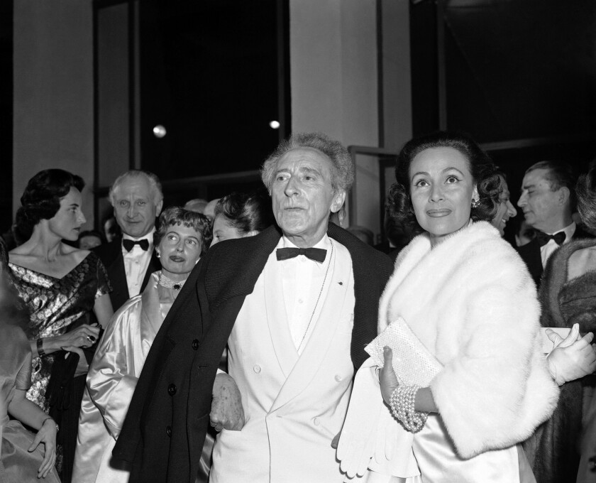 Film director Jean Cocteau and Dolores Del Rio in Cannes on May 2, 1957.