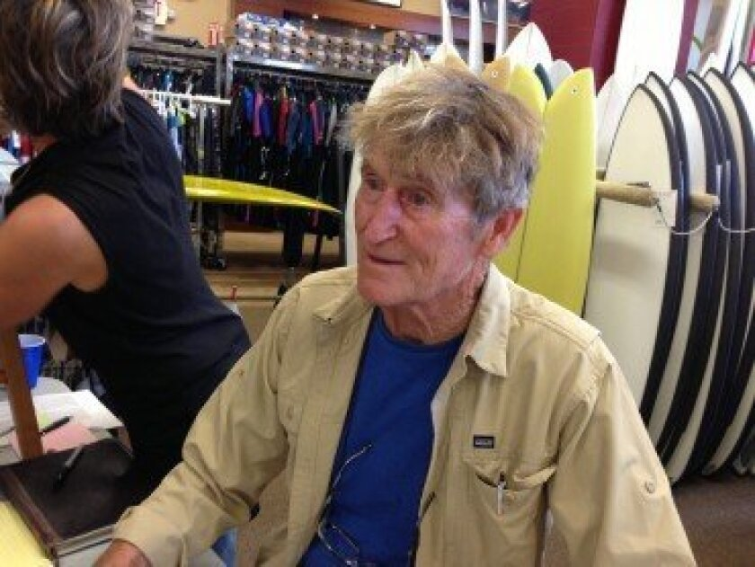 Rusty Miller signs his new book, 'Turning Point,' at Hansen Surfboards in Encinitas. Courtesy Marisa Vallbona