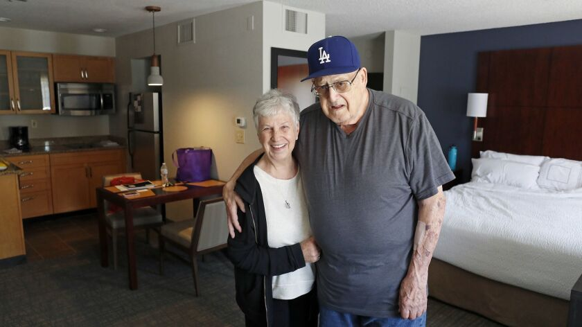 Joan and Harold Leevan pose for a portrait at the Residence Inn by Marriott Huntington Beach in Foun