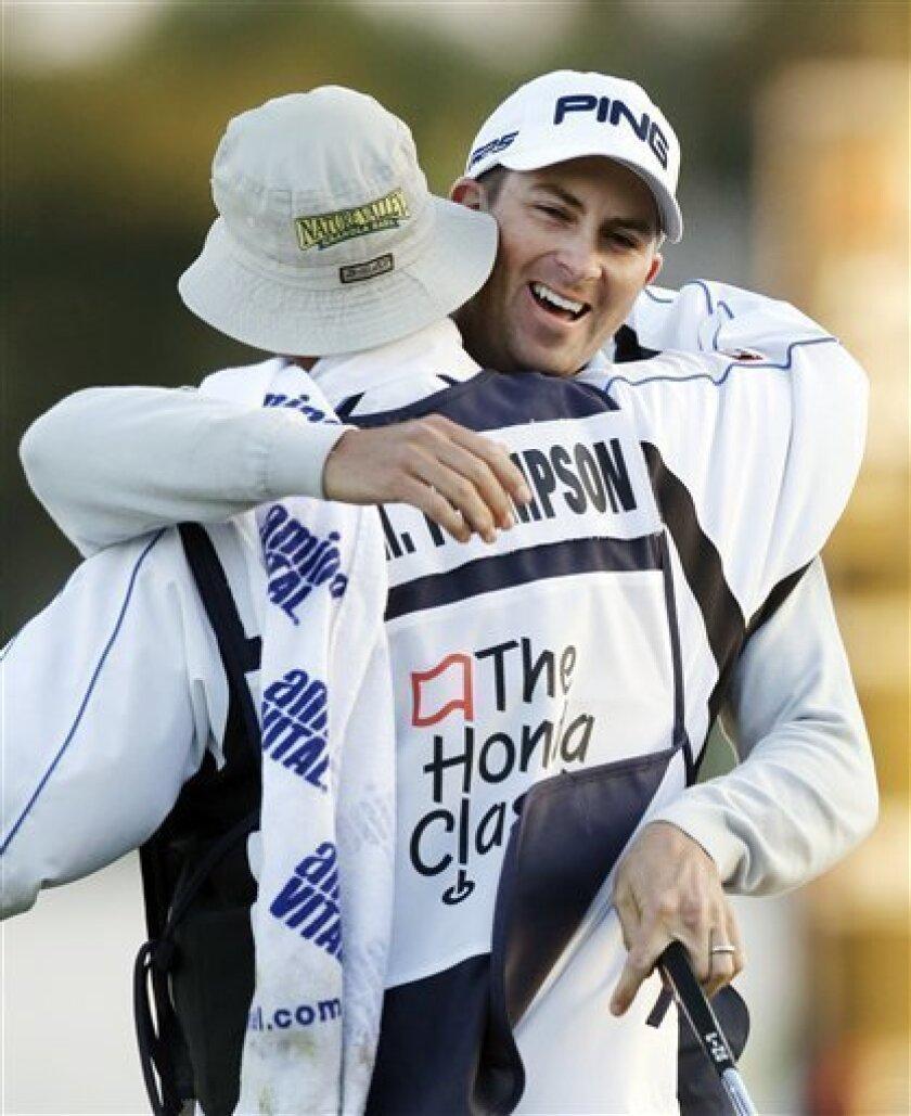 Michael Thompson, rear, hugs caddie Matt Bednarski after winning the Honda Classic golf tournament, Sunday, March 3, 2013, in Palm Beach Gardens, Fla. (AP Photo/Wilfredo Lee)