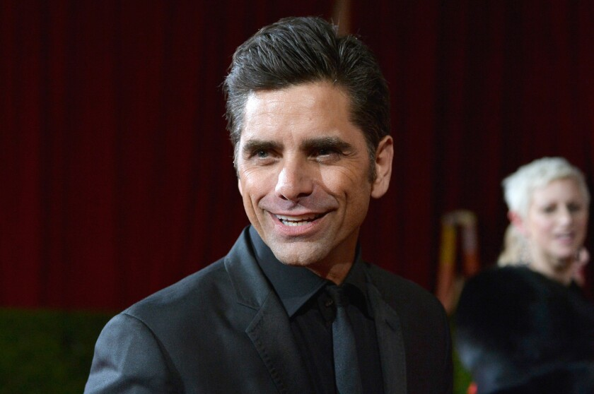 John Stamos tweets his return after a reported stint in rehab for substance-abuse treatment.