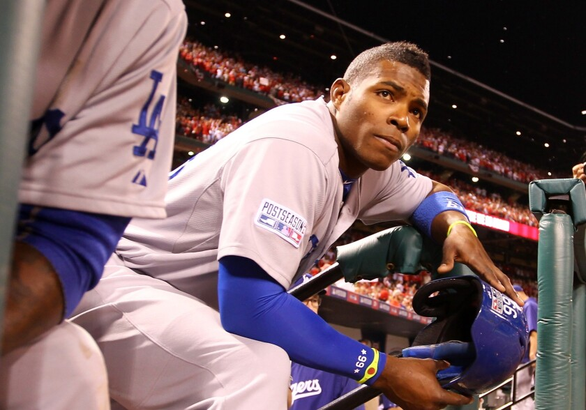 Yasiel Puig looks on from the dugout after the Dodgers were eliminated from the postseason by the St. Louis Cardinals in the National League Division Series on Oct. 7.