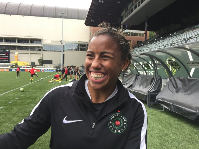 Meg Morris laughs during training with the Portland Thorns at Providence Park on Wednesday, May 25, 2016, in Portland, Ore. Morris is making the most of her chance with the Portland Thorns. Signed last month, Morris is one of many athletes who play in the National Women's Soccer League because they love the game. (AP Photo/Anne M. Peterson)