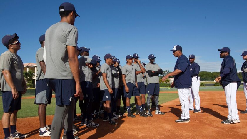Padres outfield and base-running coordinator Tony Tarasco instructs prospects at the team's Dominican academy on Feb. 2.