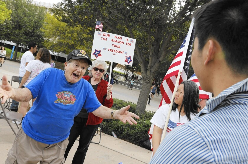 World War II veteran Joseph Borda and UC Irvine student Peter Lim exchange words on campus.