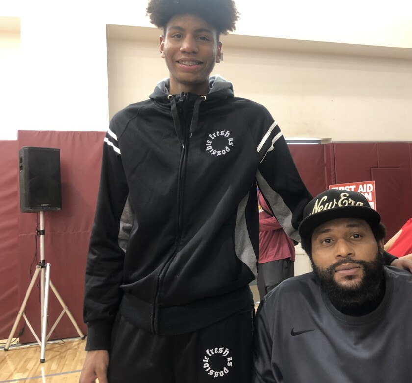 Etiwanda's Tyree Campbell (left) with his father, Zerrick, who was involved in a serious car accident last August that required amputation of his legs.