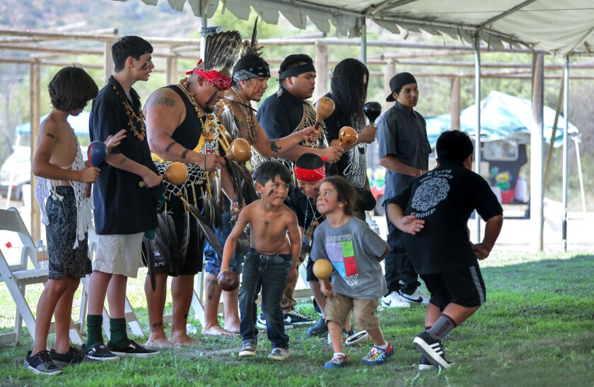 The Kupa Song and Dance group performs at the beginning of the Honoring Traditions Gathering.