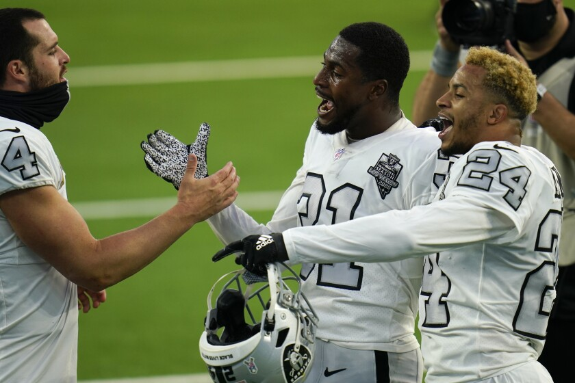 Las Vegas Raiders quarterback Derek Carr, left, celebrates with teammates cornerback Isaiah Johnson, center, and strong safety Johnathan Abram (24) after the Raiders defeated the Los Angeles Chargers in an NFL football game Sunday, Nov. 8, 2020, in Inglewood, Calif. (AP Photo/Alex Gallardo)