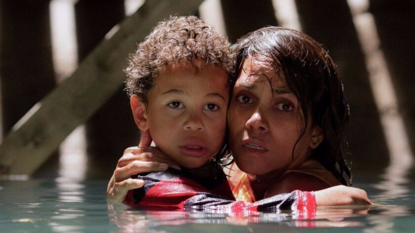 "Halle Berry as Karla and Sage Correa as Frankie in the film ""Kidnap."""