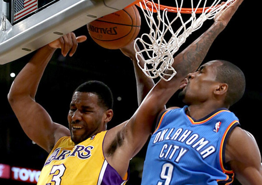 Shawne Williams has been named NBA D-League performer of the week. Above, while playing last month with the Lakers, Williams has a shot blocked by the Thunder's Serge Ibaka.