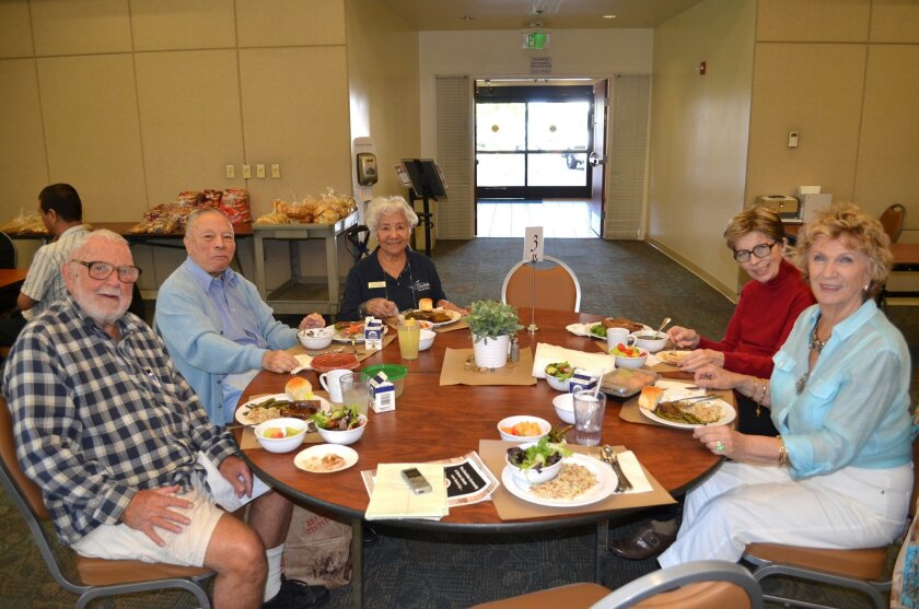 Seniors enjoy the revamped menu at the Encinitas Community and Senior Center, courtesy of the nonprofit Kitchens for Good.