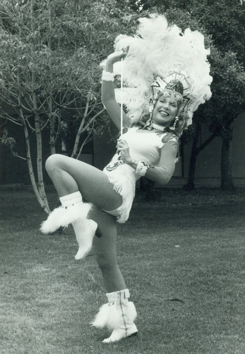 Marion Caster Baker reenacts her majorette performance about 30 years after her days at San Diego State.
