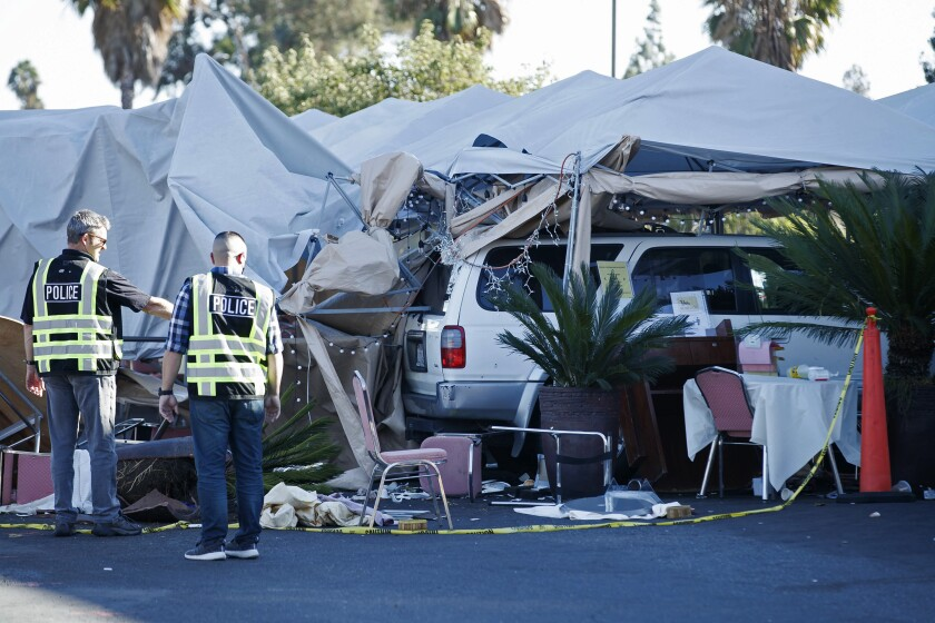 """Police investigate the area where a driver slammed into an outdoor dinning area at Grand Century Plaza in San Jose, Calif., on Sunday, Oct. 11, 2020. Two people were in critical condition Monday after being injured when a man drove his SUV into an outdoor dining area, hitting a pedestrian and several diners in Northern California, authorities said. Eight people were taken to the hospital with injuries described as """"major to minor."""" (Randy Vazquez/ Bay Area News Group via AP)"""