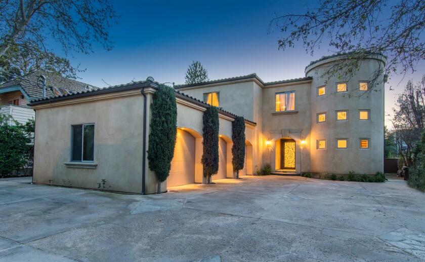 The Mediterranean-style house.