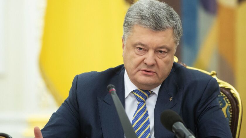 Ukrainian President Petro Poroshenko leads the National Security and Defence Council meeting in Kiev