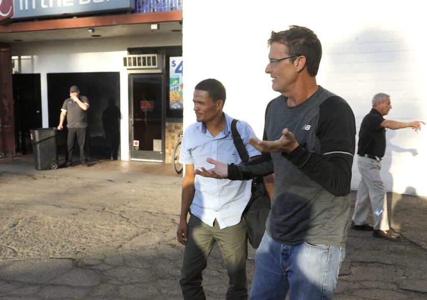 Calexico, CA_4_9_19_ Kelly Overton, founder of Border Kindness, right, reacts after picking up Redin