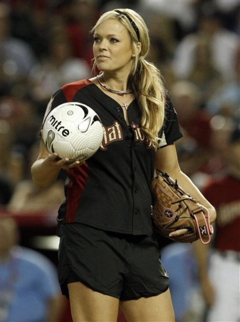 Former U.S. Olympic softball pitcher Jennie Finch prepares to pitch a soccer ball to Carlos Bocanegra during the All Star Celebrity Softball game Sunday, July 10, 2011, in Phoenix. (AP Photo/Ross D. Franklin)