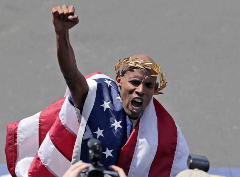 April 21, 2014: Meb Keflezighi, of San Diego, celebrates his victory in the 118th Boston Marathon in Boston.