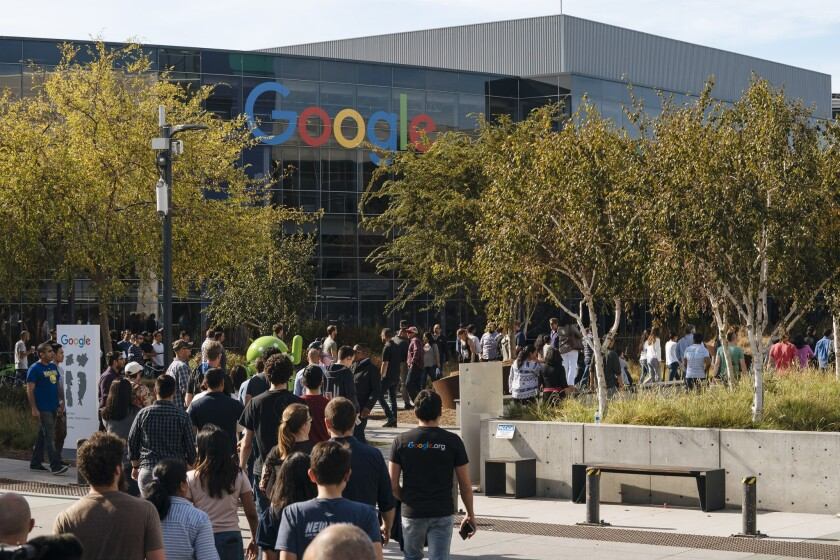 Google employees walk off the job Nov. 1, 2018, to protest the company's handling of sexual misconduct claims in Mountain View, Calif. Employees were seen staging walkouts at offices around the world after a report last week that Google gave $90 million in a severance package to Andy Rubin and covered up details of sexual misconduct allegations.