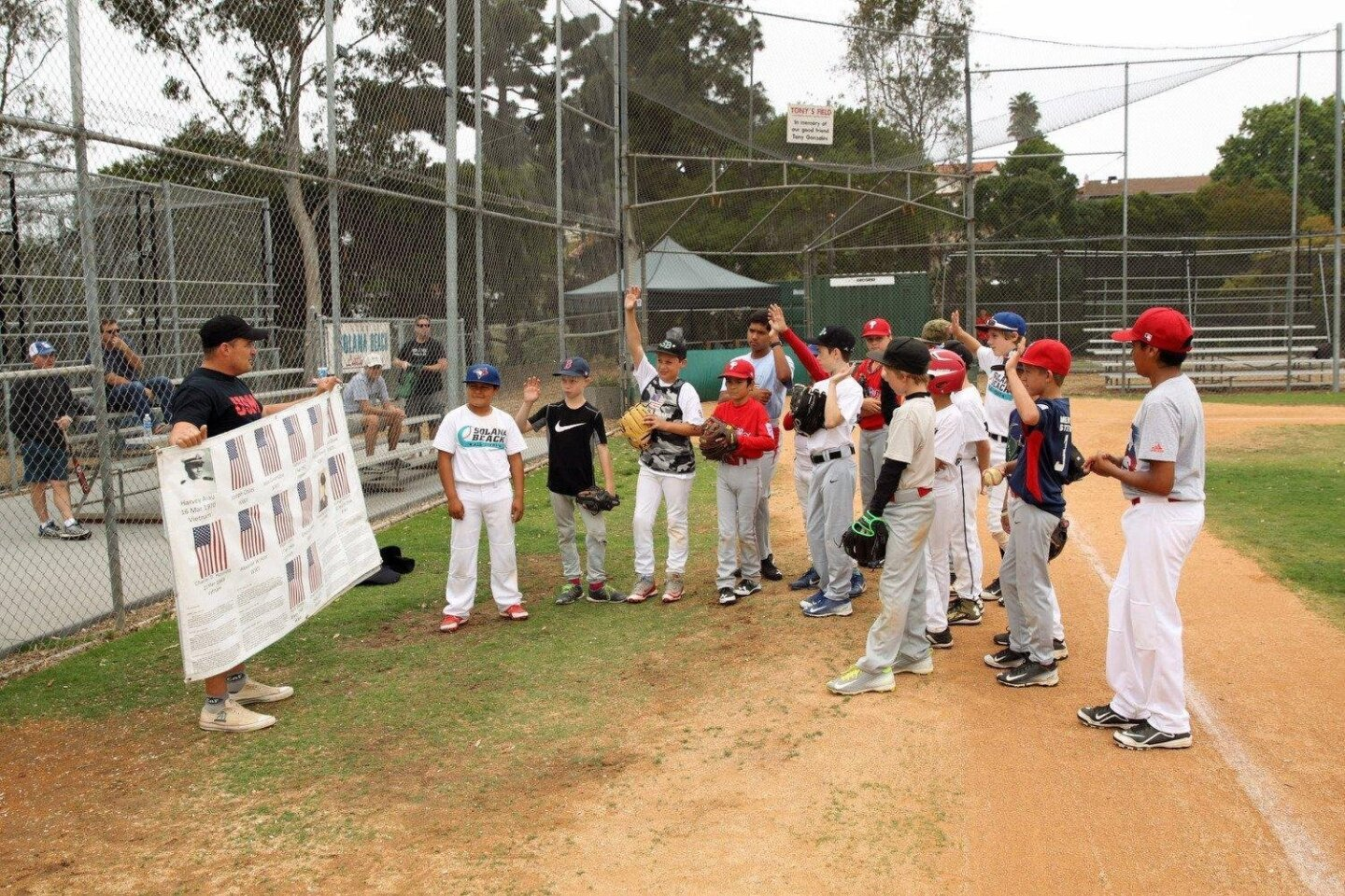 Coach Nico Marcolongo talks to the players about the meaning of Memorial Day