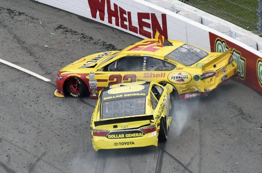 FILE - In this Nov. 1, 2015, file photo, Joey Logano (22) and Matt Kenseth (20) tangle in Turn 1 during the NASCAR Sprint Cup Series auto race at Martinsville Speedway in Martinsville, Va. It's the wild west in NASCAR right now, and it's not clear if that's good or bad for this championship battle.