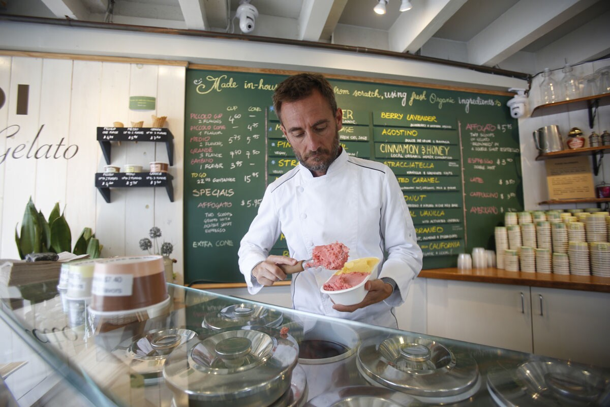 Bobboi Natural Gelato is a real Italian style gelato parlor located in La Jolla. Co-owner Marco Saba serves gelato, which Bobboi makes from scratch every day, using local fresh and organic raw materials, inside the shop. (Alejandro Tamayo/Union-Tribune)