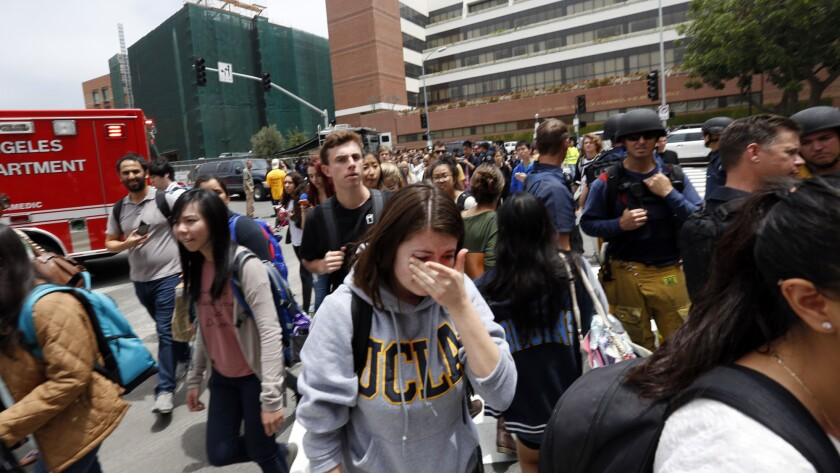 UCLA students evacuate the campus after a shooting Wednesday.