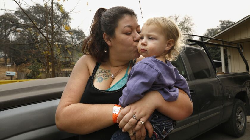 OROVILLE, CALIFORNIA--NOV.13, 2018--Megan Butler, age 26, and her daughters Aurora, age 2, and Noval