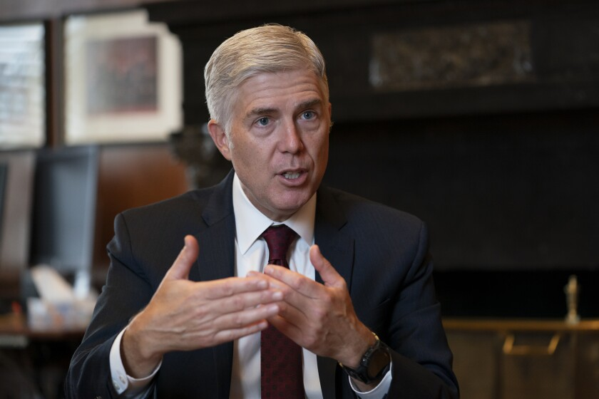 """FILE - In this Sept. 4, 2019 file photo, Justice Neil Gorsuch, speaks during an interview in his chambers at the Supreme Court in Washington. Gorsuch on Friday, Sept. 20, said the conventional wisdom that the court is split along partisan lines based on the political views of the president that appointed each justice is false. Gorsuch spoke about civility at Brigham Young University refuting the notion that judges are just """"like politicians with robes."""" (AP Photo/J. Scott Applewhite, File)"""
