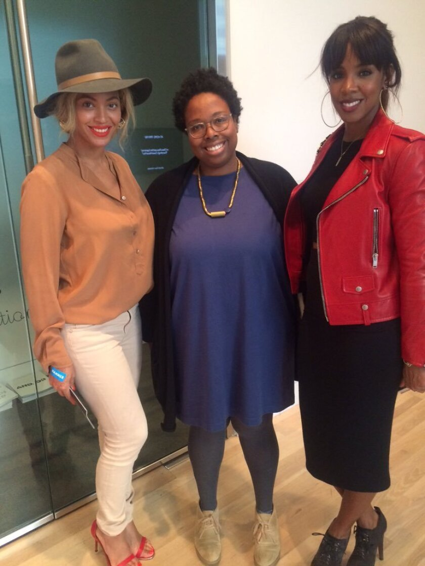 Beyoncé, Hammer Museum assistant curator Jamillah James and Kelly Rowland at the Westwood museum on Tuesday.