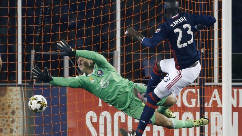 Kei Kamara (23) scores on Orlando City goalie Joseph Bendik while playing for the New England Revolution in 2017.