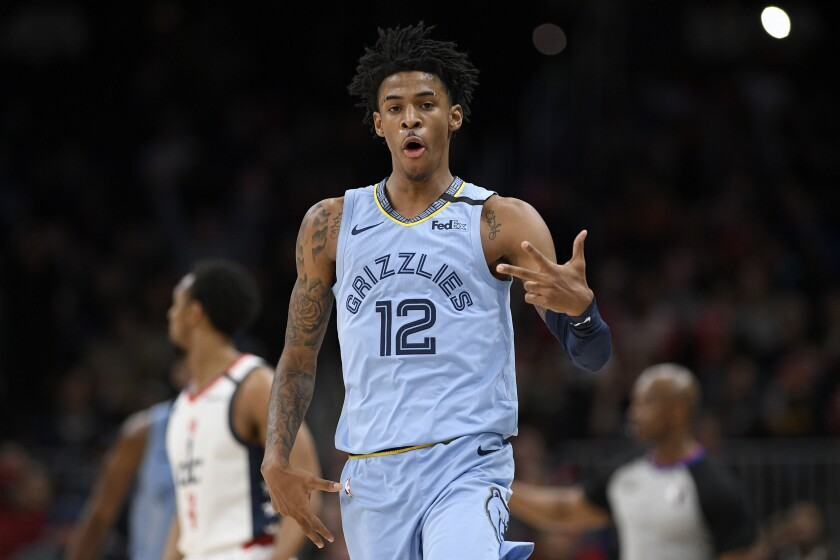 Memphis Grizzlies guard Ja Morant (12) gestures after a basket during the second half of an NBA basketball game against the Washington Wizards, Sunday, Feb. 9, 2020, in Washington. The Grizzlies won 106-99. (AP Photo/Nick Wass)