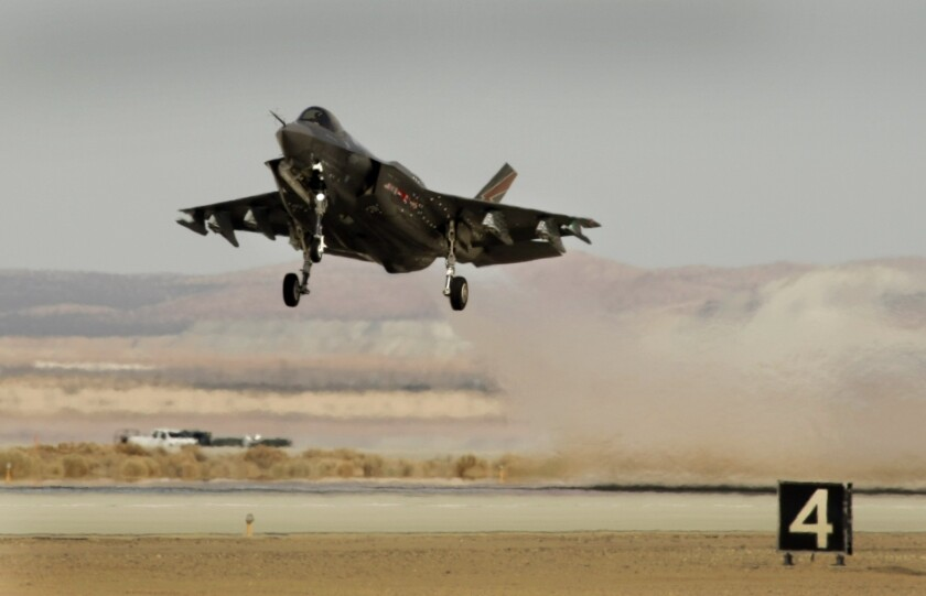 The Lockheed Martin F-35 Lightning II lifts off during testing at Edwards Air Force Base.