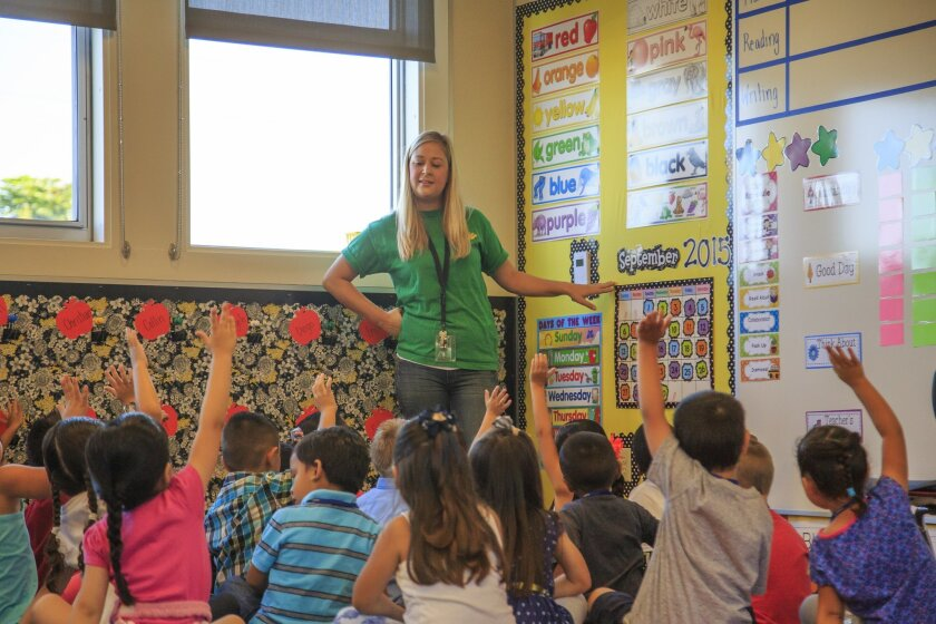 Melissa Ryan asks a question to her kindergarten class during the first day of class at Hilltop Drive Elementary School during the first day of class. September 8, 2015. Photo by David Hodges.