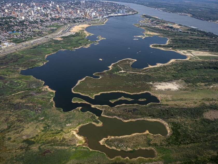 The banks of Asuncion Bay are exposed as the Paraguay River hits a historic low during a drought in Asuncion, Paraguay, Thursday, Sept. 23, 2021. (AP Photo/Jorge Saenz)