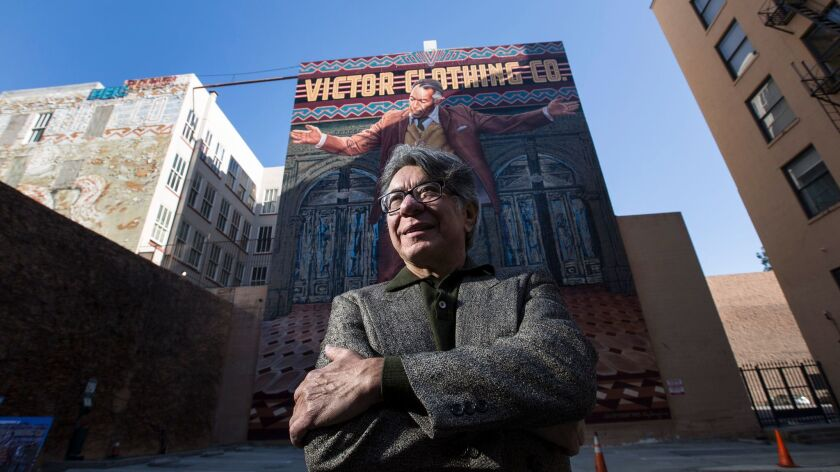 "Artist Eloy Torrez and his newly restored downtown mural of Anthony Quinn, the ""Pope of Broadway."""