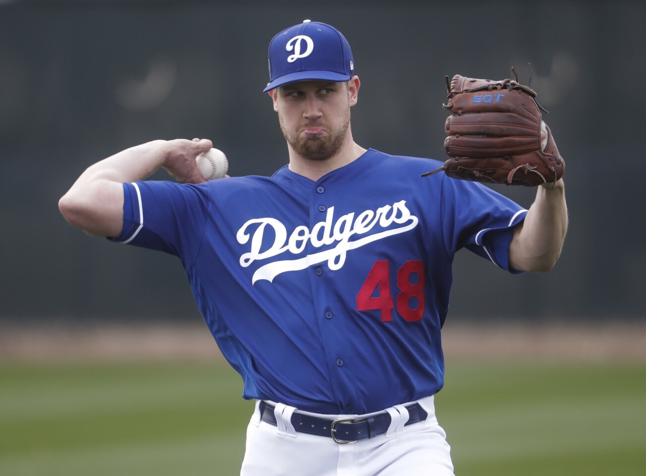Los Angeles Dodgers' Brock Stewart throws during a spring training baseball workout Wednesday, Feb. 13, 2019, in Glendale, Ariz. (AP Photo/Morry Gash)