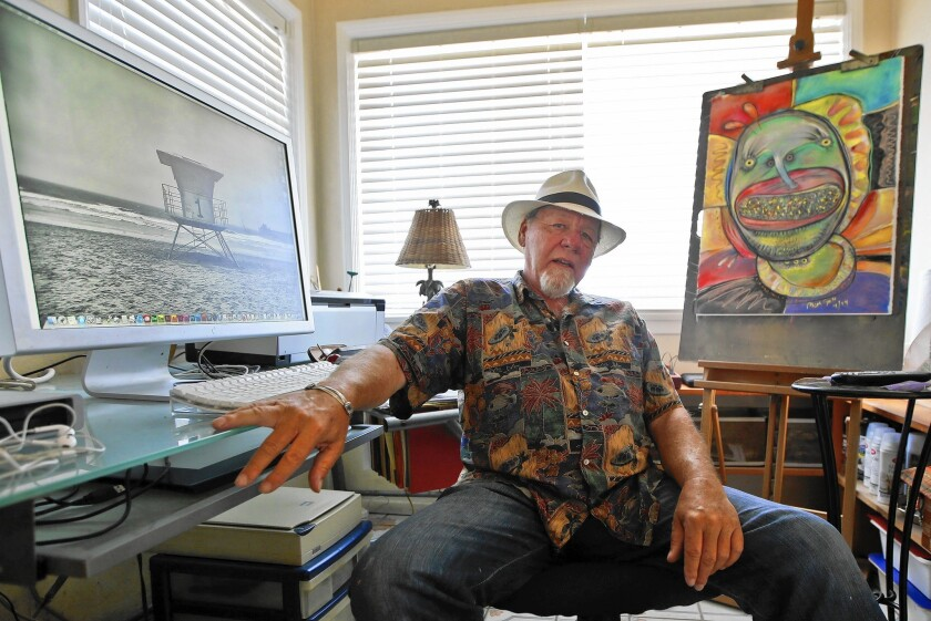 Michael Gross in his studio in Oceanside last year. Long before creating the 'Ghostbusters' film logo, he was art director at National Lampoon.