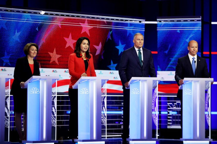From left, Minnesota Sen. Amy Klobuchar, Hawaii Rep. Tulsi Gabbard, Washington Gov. Jay Inslee and former Maryland Rep. John Delaney participate in the candidate debate in Miami in June. All four are at risk of not making the cut for debates in the fall.