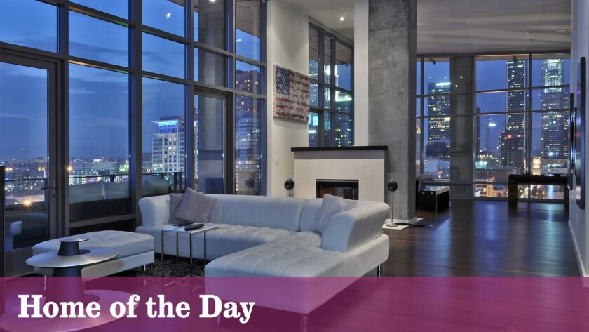 Sleek finishes, walls of windows and panoramic views highlight this $5-million penthouse in downtown Los Angeles.