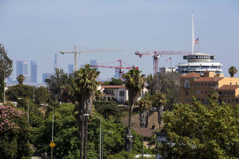 View of Hollywood. A New York-based developer wants to build two new skyscrapers flanking the iconic Capitol Records building.