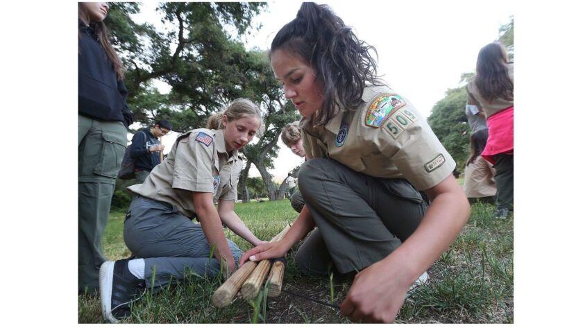 Senior patrol leader Lainy Dickson, 16, of La Crescenta, and scout Allison King, 16, of La Canada, u