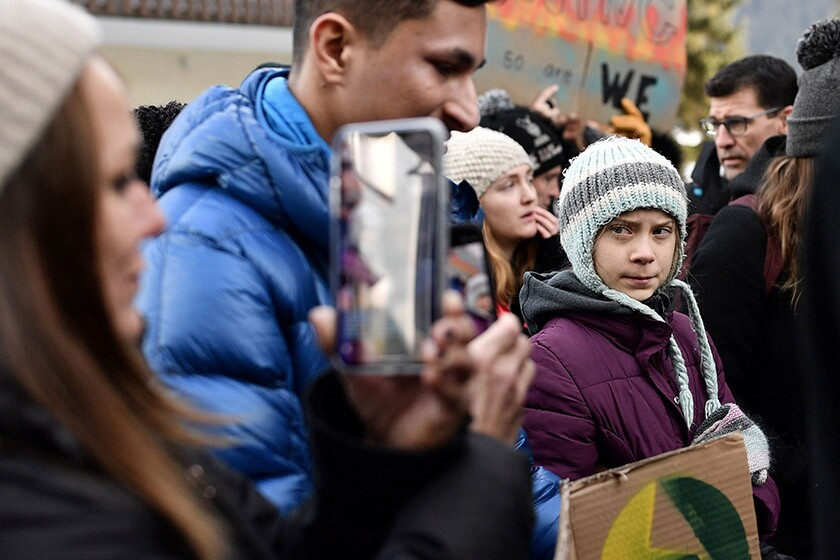 """Swedish climate activist Greta Thunberg marches during a """"Fridays for Future"""" demonstration on a street in Davos, Switzerland, on Friday."""
