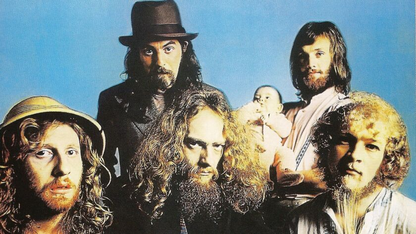 """Jethro Tull is shown in a 1972 photo from the Japanese CD reissue of its album """"Living in the Past."""" The defunct band's leader, Ian Anderson, is seated front and center. He will launch a Jethro Tull 50th anniversary tour in 2018, minus Jethro Tull."""