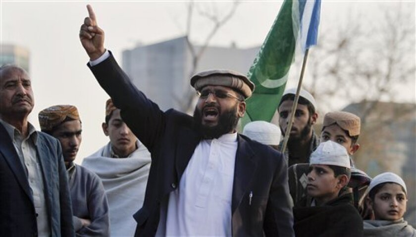 A supporter of Pakistani religious party Jamat-e-Islami chants slogans during a demonstration against a U.S. consular employee who is the lead suspect in the shooting deaths of two Pakistani men, in Islamabad, Pakistan, Sunday, Jan. 30, 2011. The United States on Saturday demanded the immediate rel