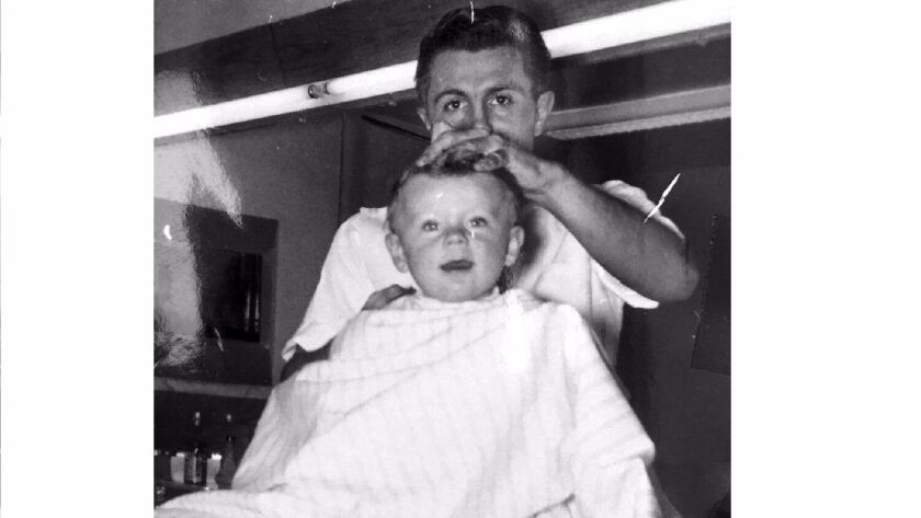 Rick Lind, at 8 months old, is the first customer at Ernie's Barber Shop in Glendale in 1955.