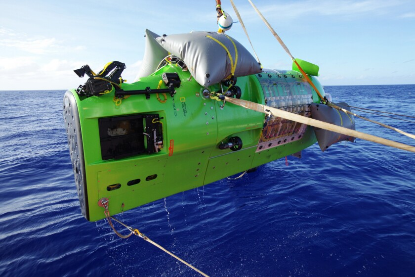 """The Deepsea Challenger is lifted from the Pacific Ocean in a scene from """"Deepsea Challenge 3D."""""""