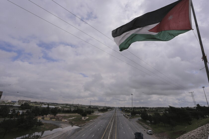Jordan's flag flies over empty streets.