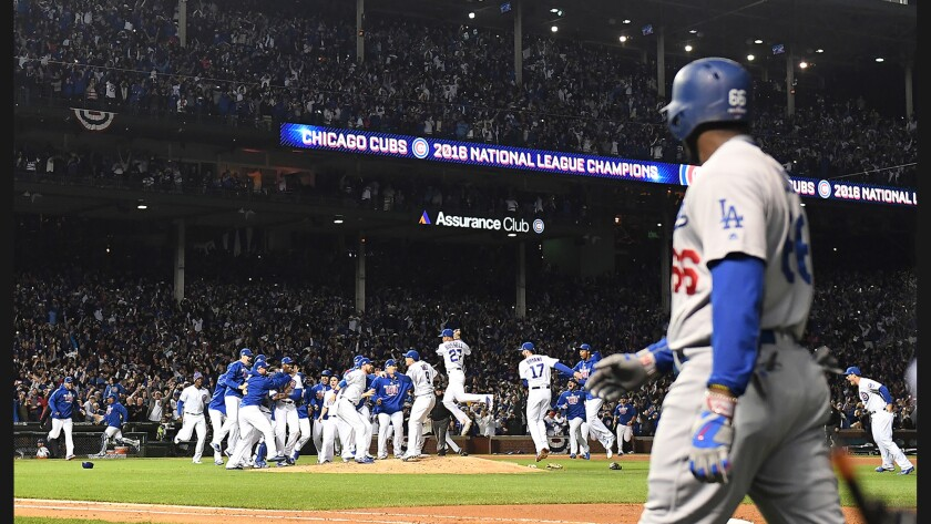 Dodgers outfielder Yasiel Puig walks off the field as the Chicago Cubs celebrate winning the NLCS at Wrigley Field in October.